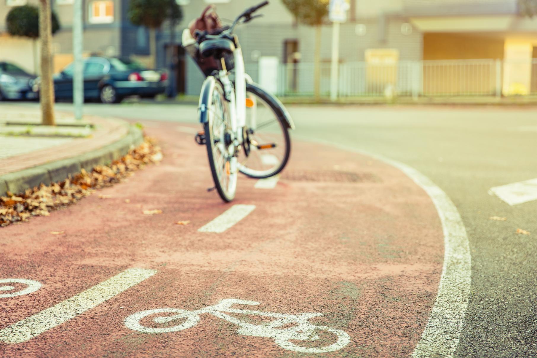 bicycle-road-symbol-over-street-bike-lane-with-bic-97D3YWS
