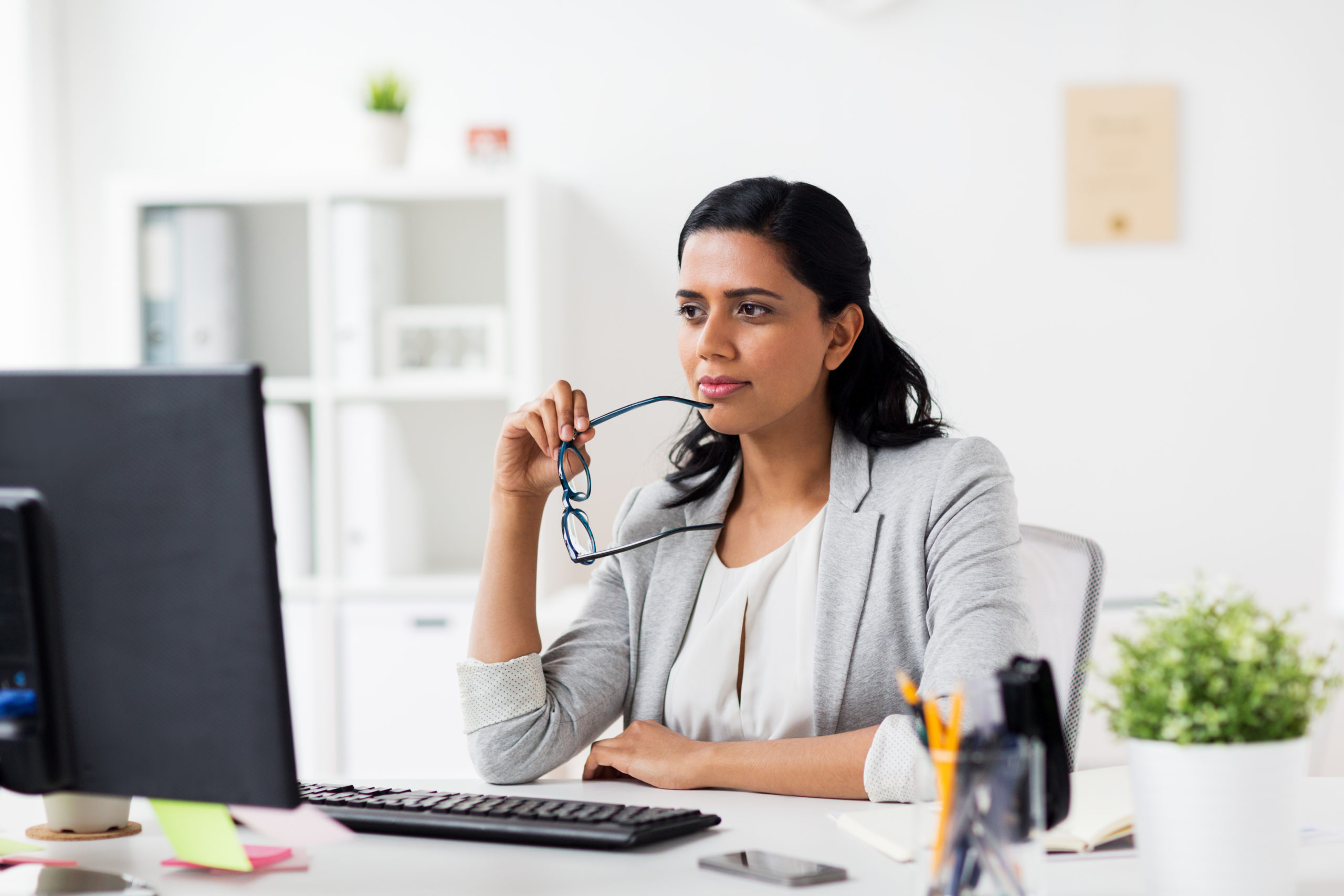 businesswoman with glasses and computer at office