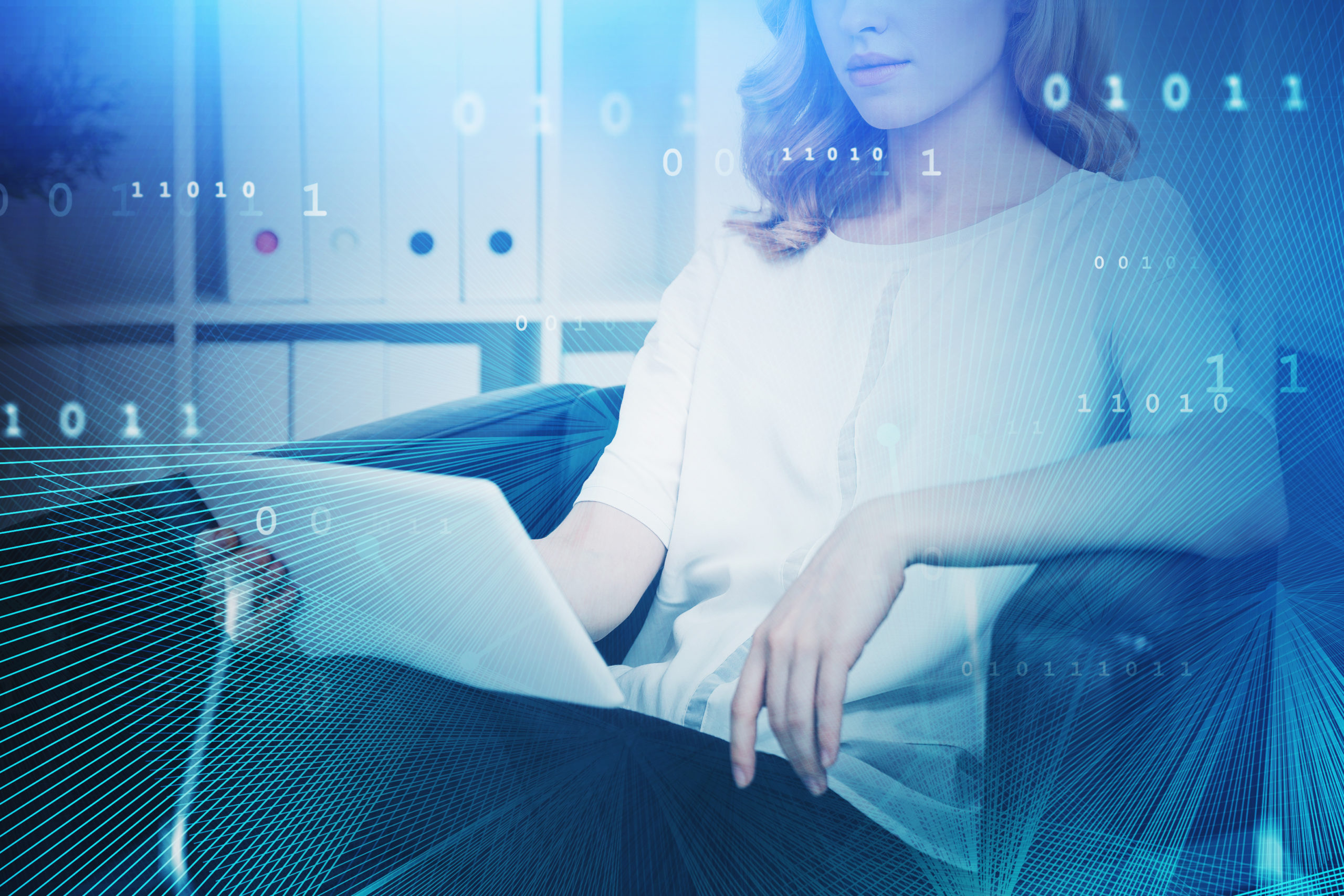 Woman with laptop in office, network interface